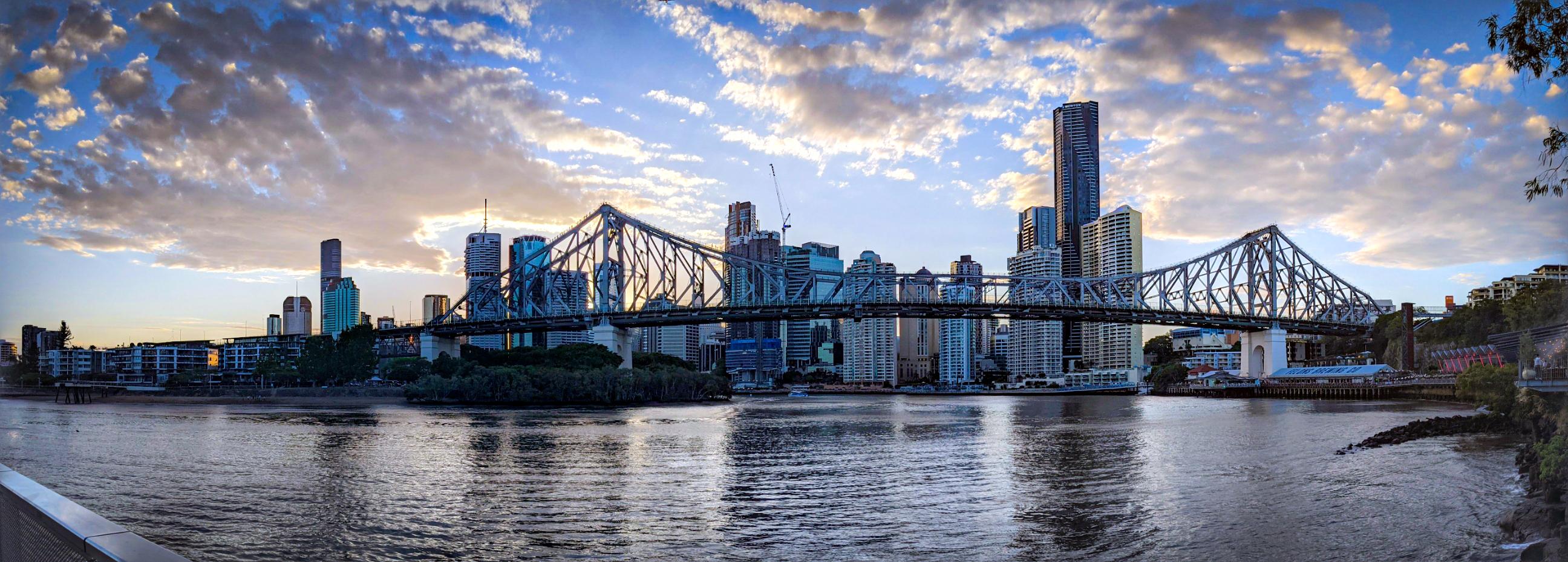 Panoramic sunset shot of the Storey Bridge and Brisbane CBD