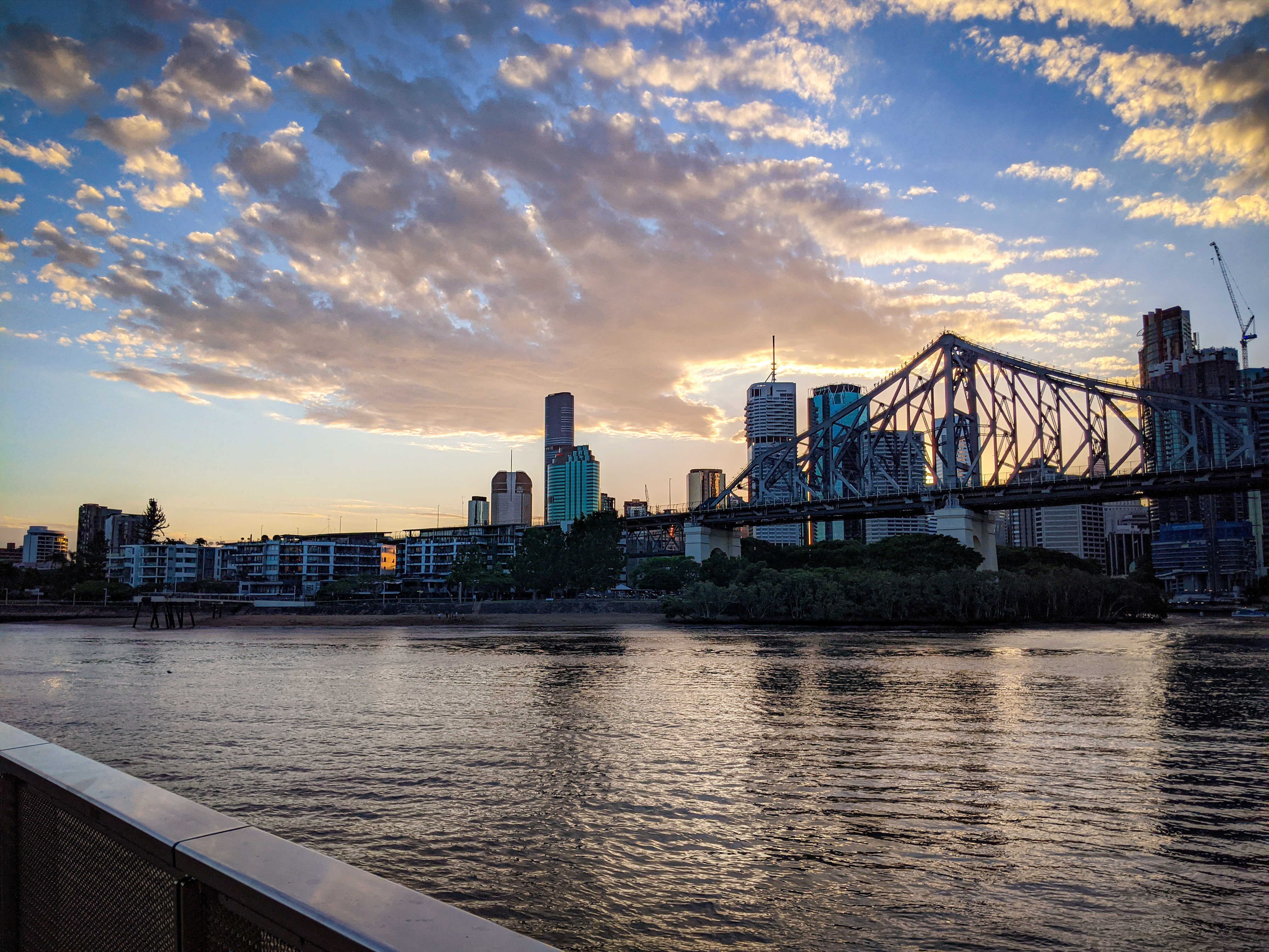 The south support of the Storey Bridge with sunset behind the Brisbane CBD